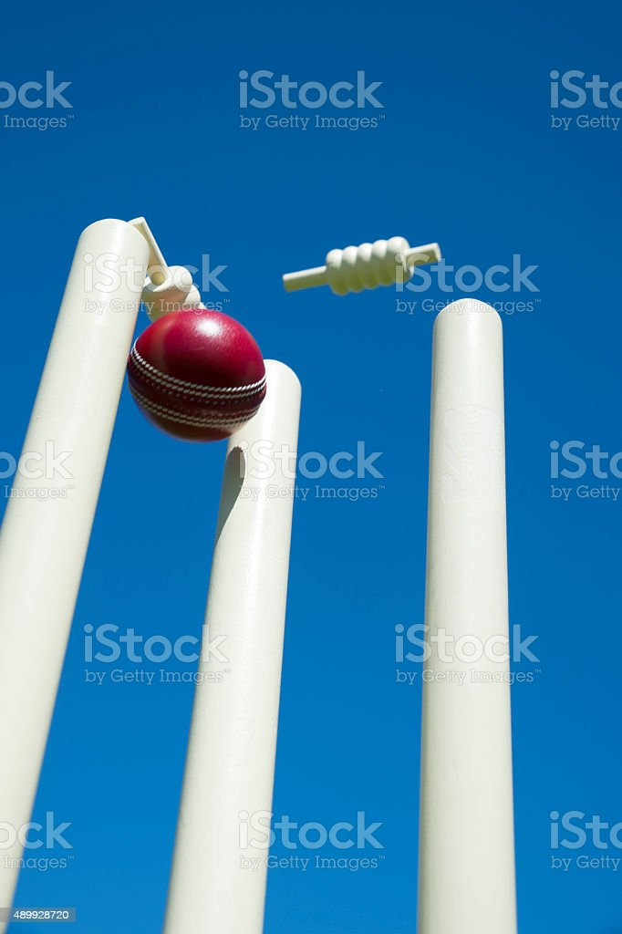 Cricket ball and stumps stock photo