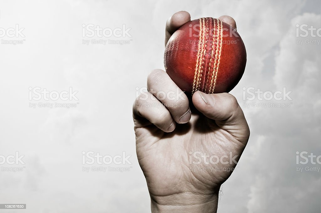 Cricket ball in hand stock photo