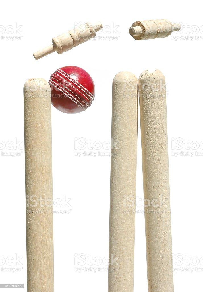 Cricket ball smashing through the bails stock photo