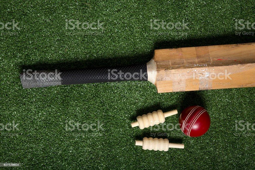Cricket bat, ball and bails stock photo