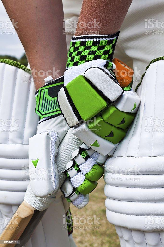 Cricket batsman holding the bat royalty-free stock photo