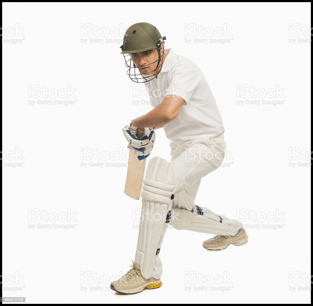 Cricket batsman playing a defensive stroke stock photo