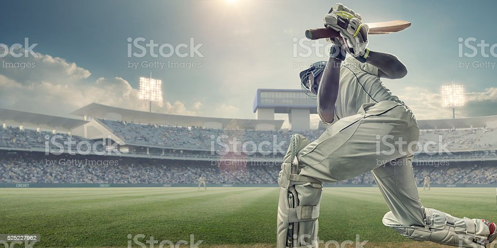 Cricket Batsman With Bat Up After Hitting Ball In Game stock photo
