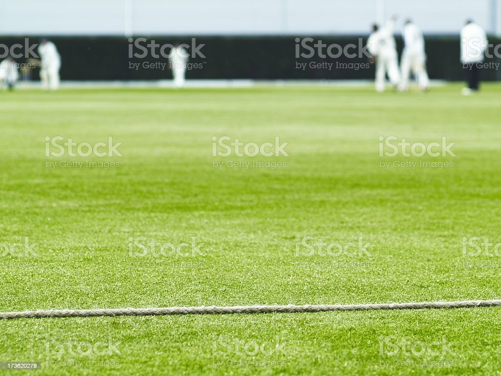 Cricket boundary rope and match action stock photo