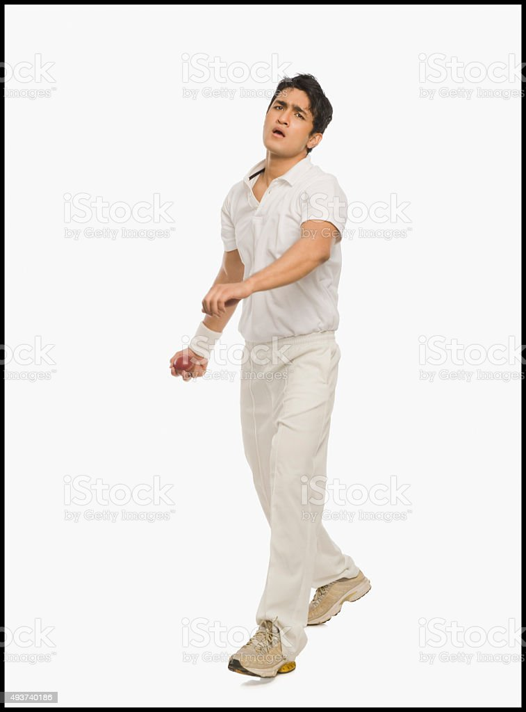 Cricket bowler in action stock photo