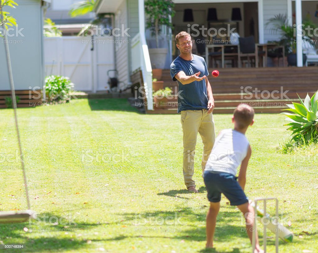 Cricket - father against son stock photo