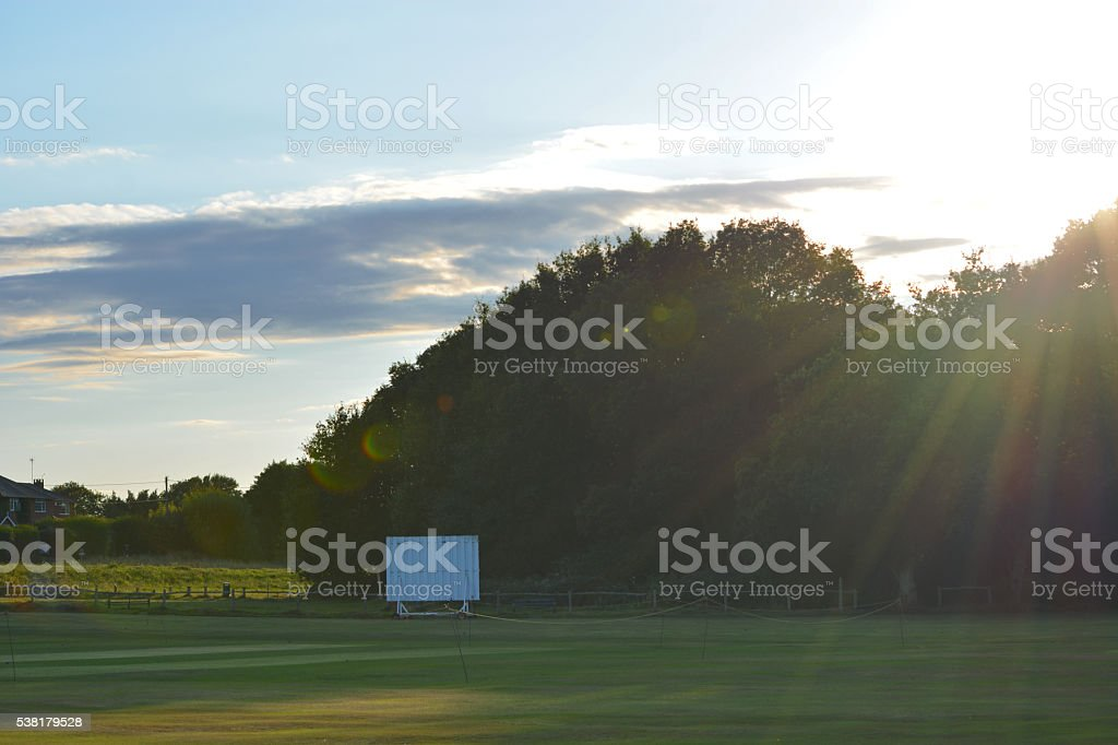 The village cricket ground and scoreboard in Henfield, Sussex, UK...