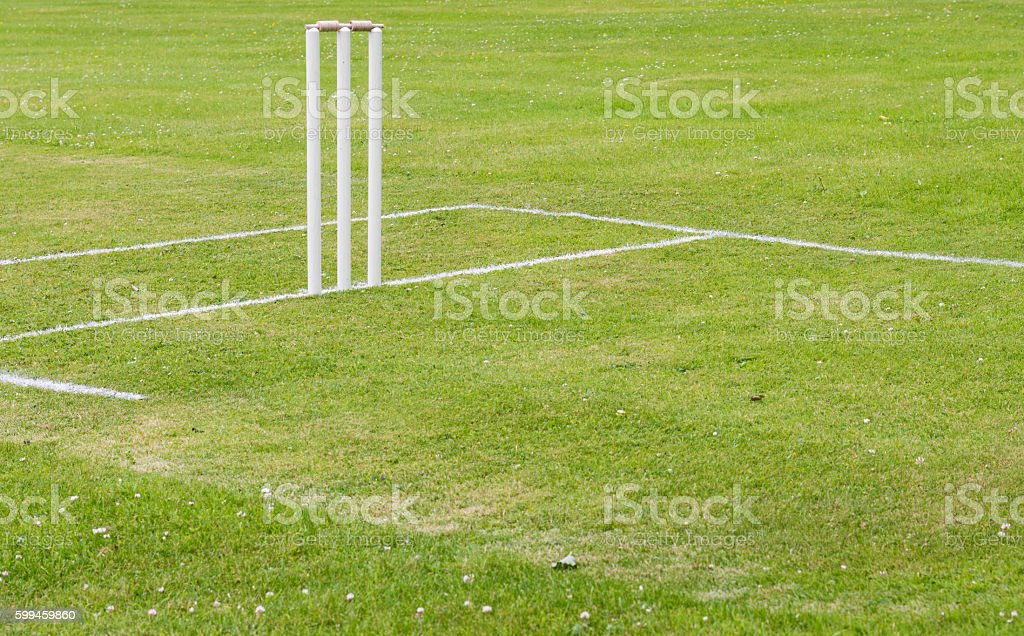 Cricket Pitch : Wickets on left of image stock photo