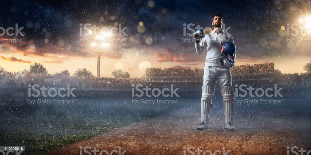 Cricket player batsman on the stadium stock photo