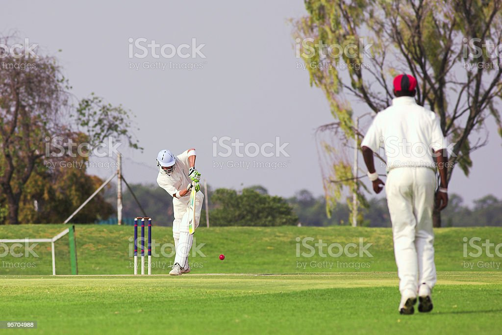 Cricket player hitting ball royalty-free stock photo