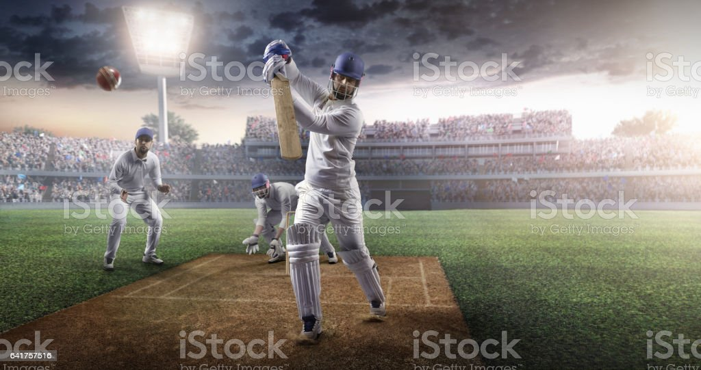 Cricket batsman bouncing a ball. All the team is wearing unbranded...