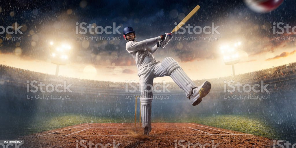 Cricket batsman bouncing a ball. He is wearing unbranded sports cloth...