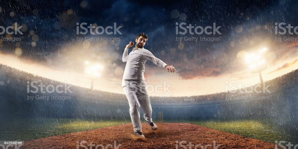 Cricket pitcher throws a ball. He is wearing unbranded sports cloth...