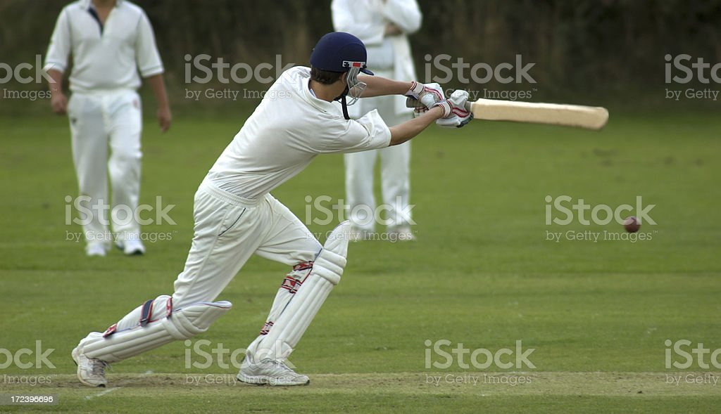 Cricketer playing cut shot stock photo