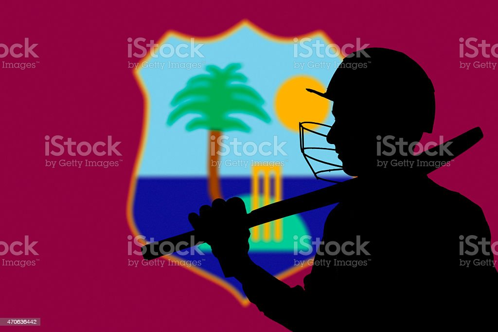 Cricketer silhouette on West Indies blurred flag background stock photo