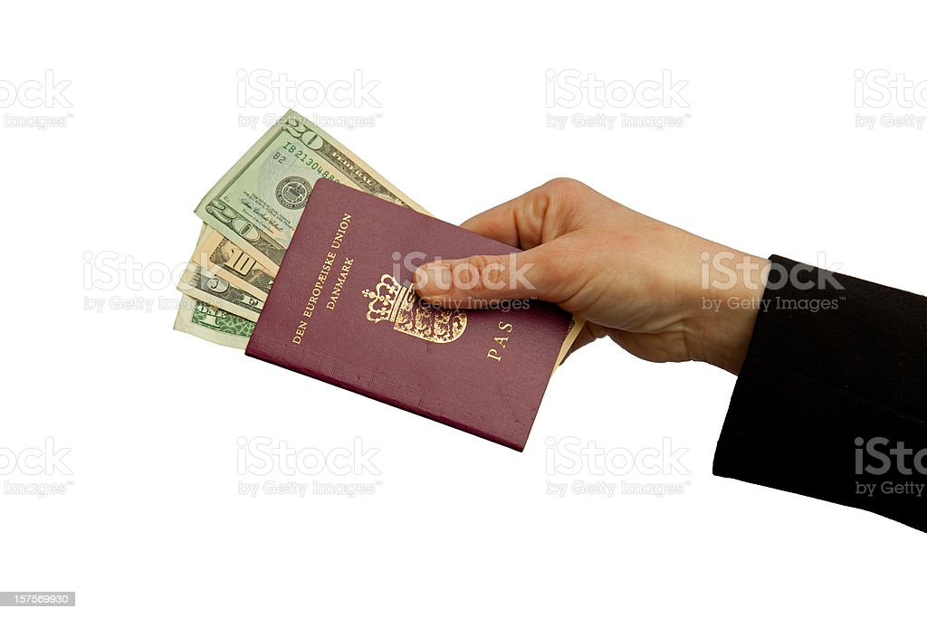 Crime Business travel Danish passport with dollar bribing and corruption royalty-free stock photo