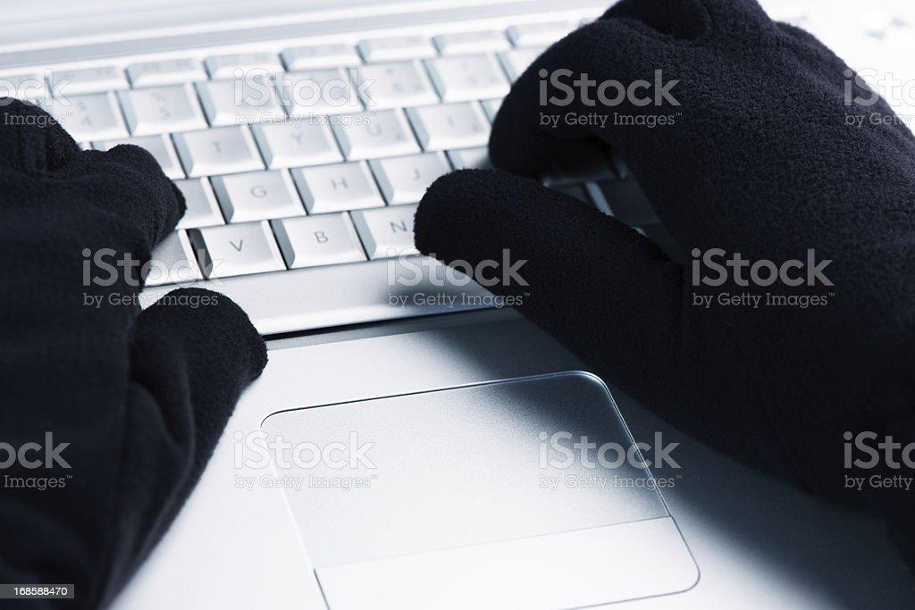 IT Crime  Hacker works on laptop stock photo