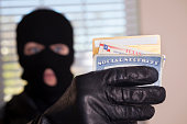 Crime: Masked theif steals identification cards.