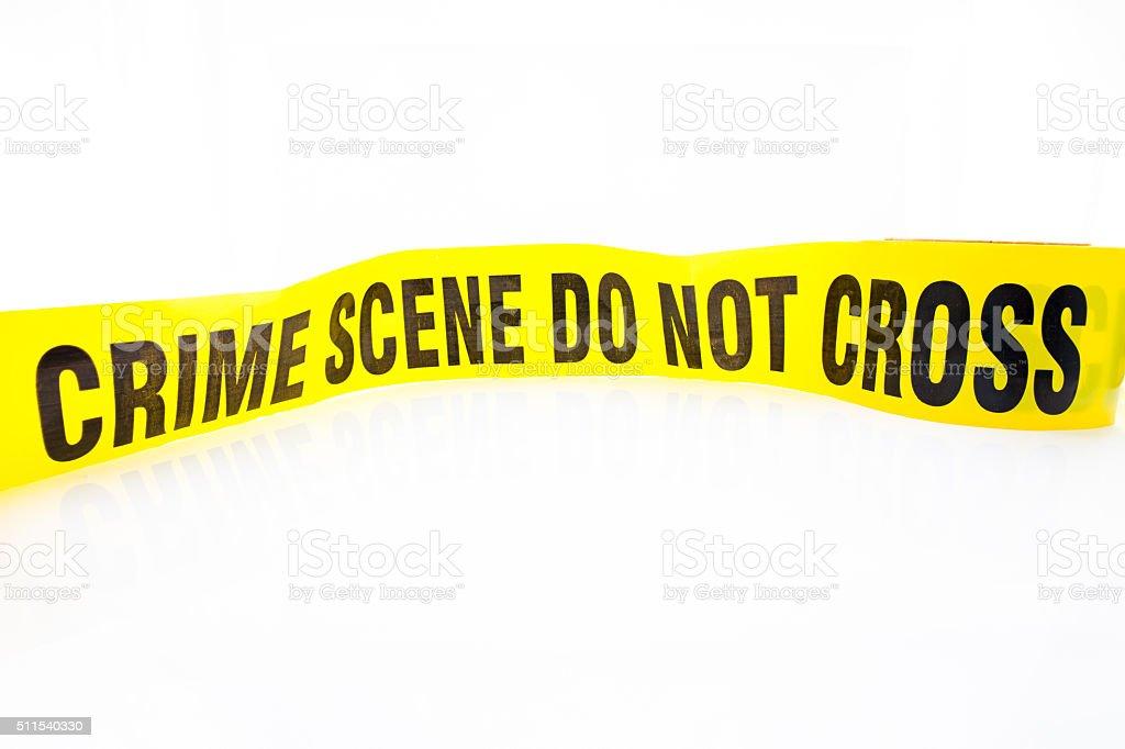 crime scene do not cross tape stock photo