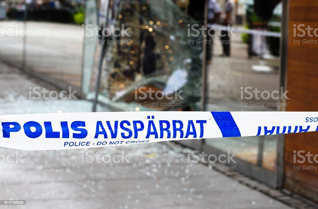 Crime scene investigation police do not cross boundary tape stock photo