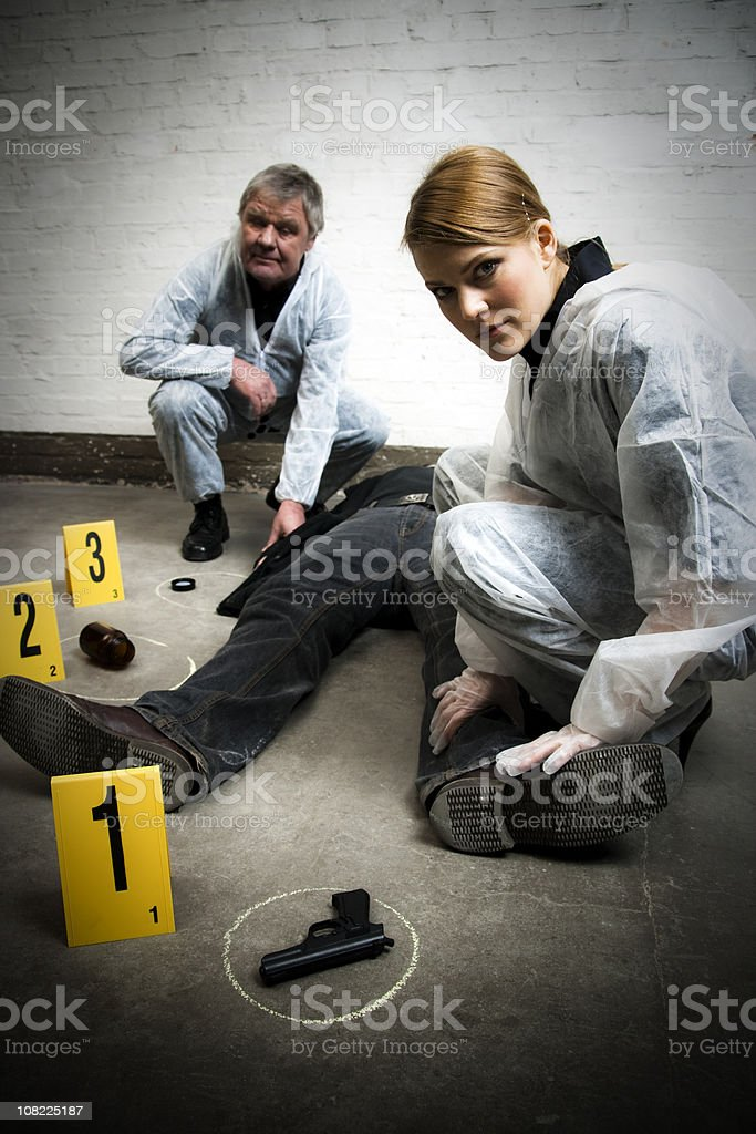Crime Scene Investigation with Dead Body and Gun royalty-free stock photo