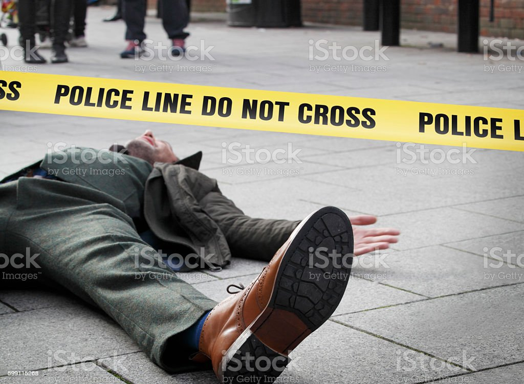 Crime scene marked with police line stock photo