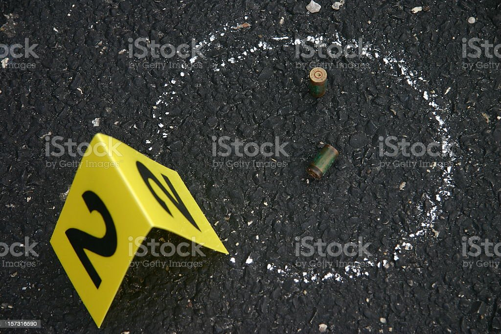 Crime scene number and chalk outline stock photo