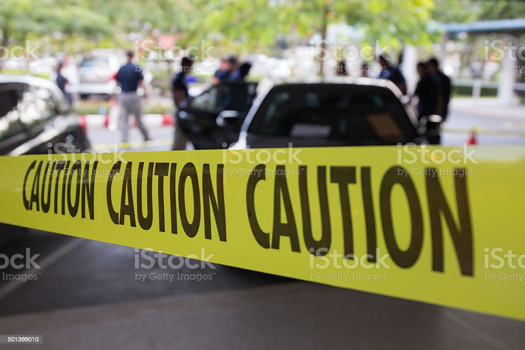 crime scene protect by caution tape stock photo