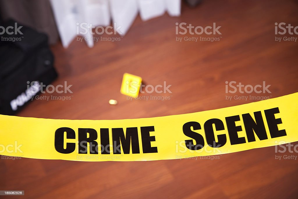 Crime scene tape in a home.  Evidence on floor. royalty-free stock photo