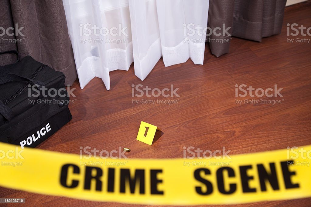 Crime scene tape in a home.  Evidence on floor. stock photo