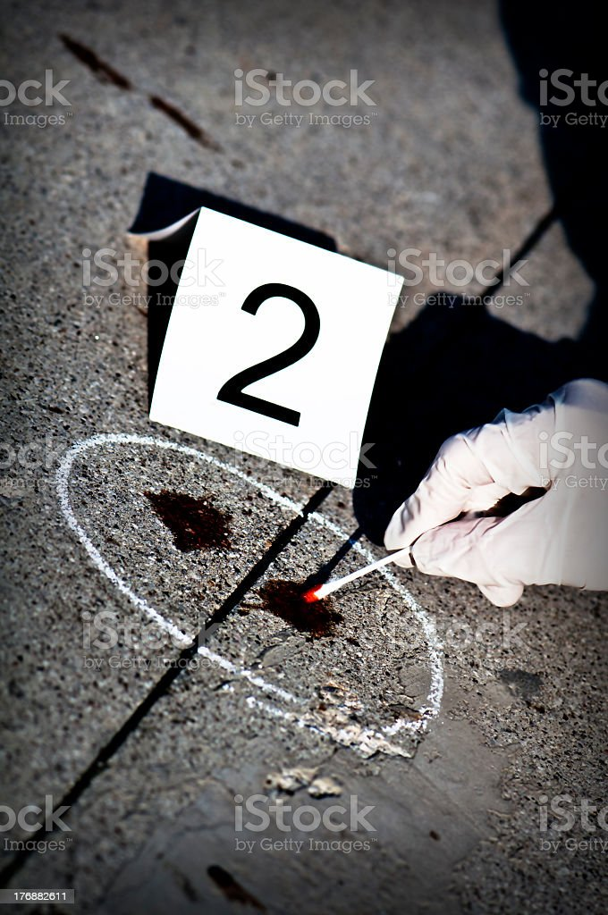 A crime scene with blood on the concrete labeled 2 royalty-free stock photo