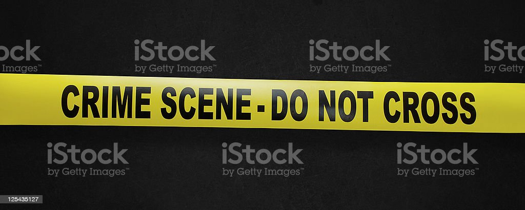 Crime scene yellow tape with clipping path stock photo