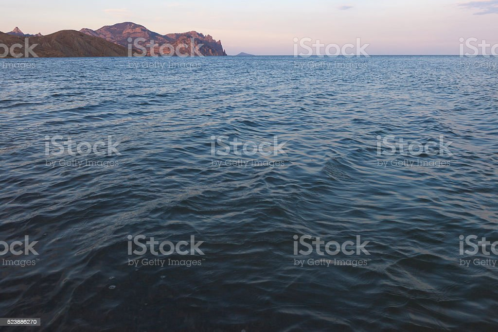 Crimea seascape at sunset with the mountains and the beach stock photo