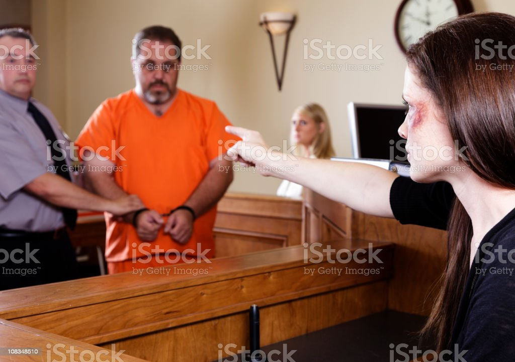 Criminal and Victim in Court royalty-free stock photo