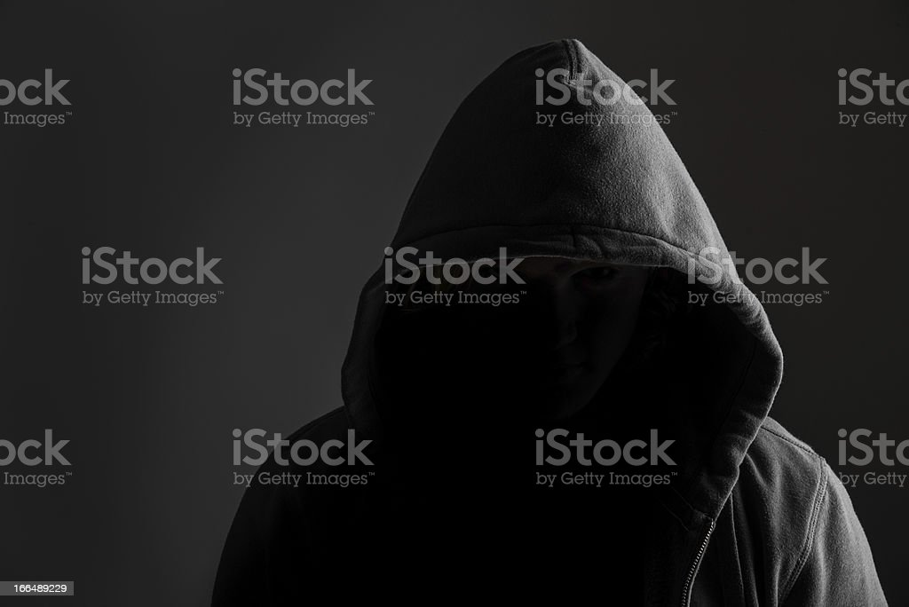Criminal in the shadows stock photo
