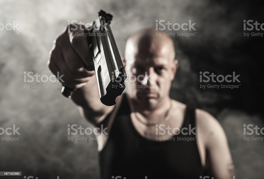 Criminal man with gun stock photo