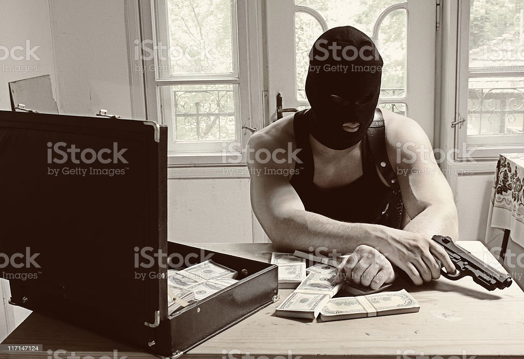 Criminal  man with mask and gun royalty-free stock photo