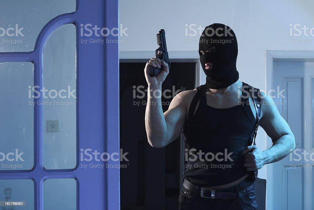 Criminal  man with mask and gun royalty-free stock photo