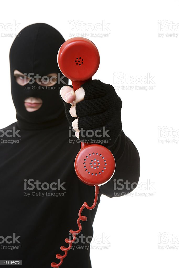 Criminal or Thief on White holding phone royalty-free stock photo