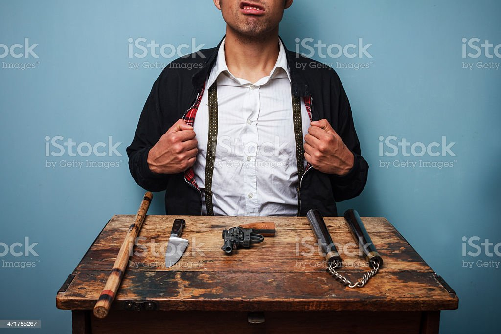 Criminal showing off his weapons royalty-free stock photo