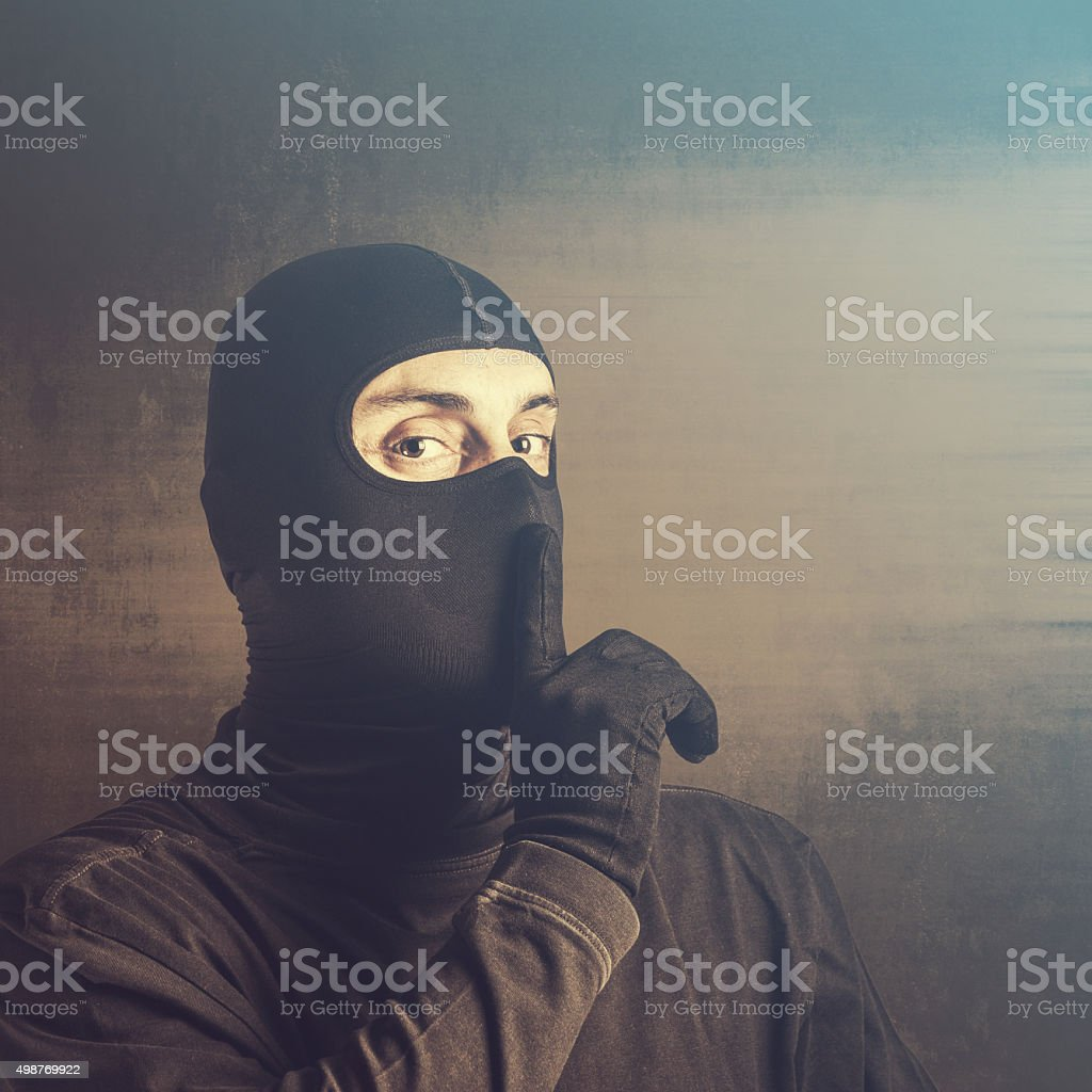 Criminal urge you to keep quiet stock photo