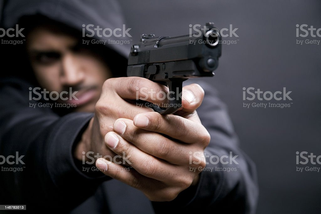 criminal with a gun stock photo
