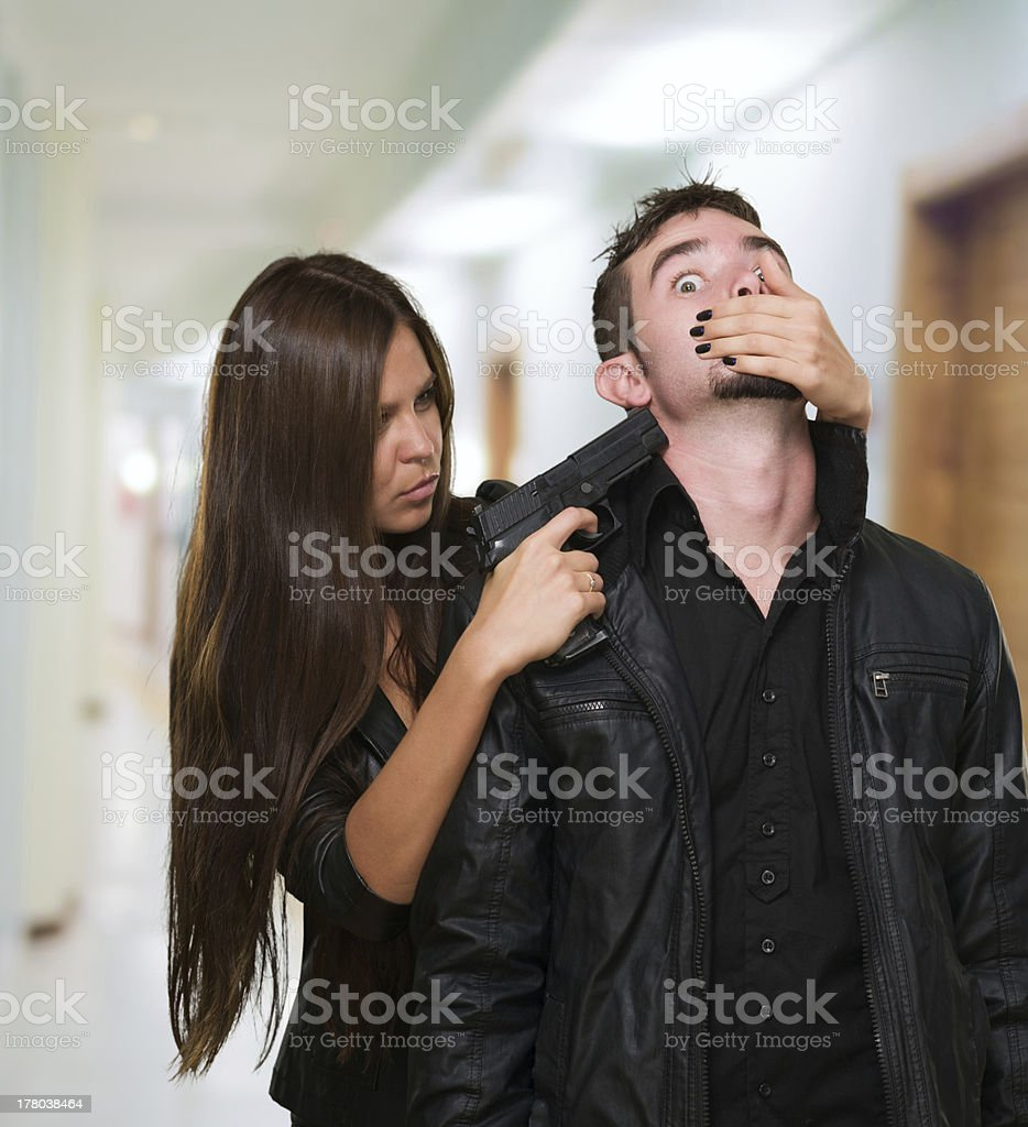 Criminal With A Gun Threatening Young Woman royalty-free stock photo