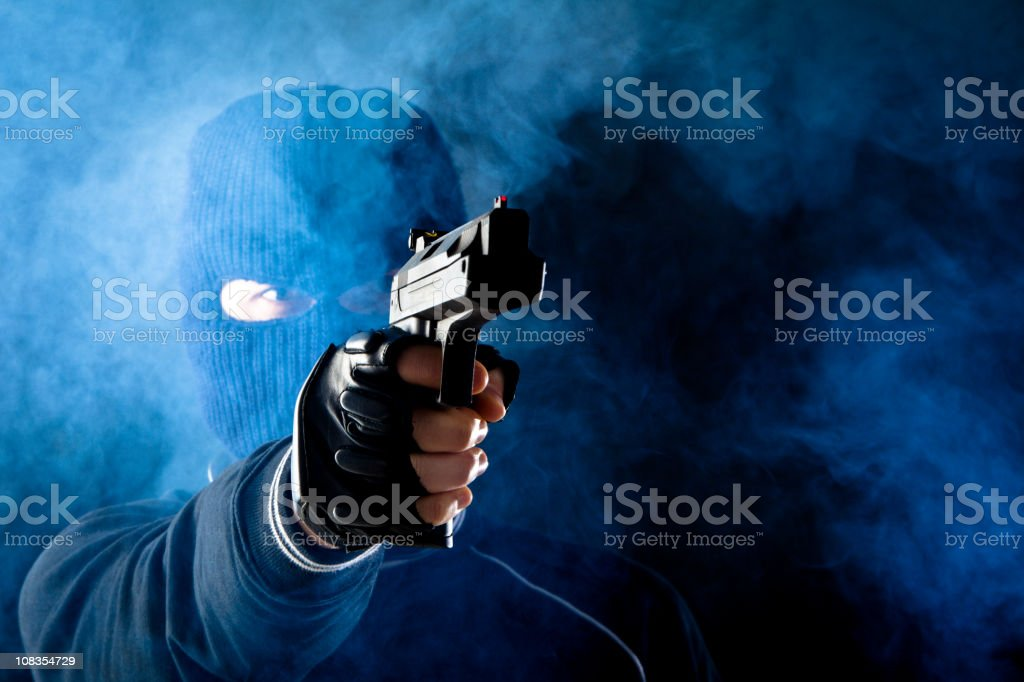 Criminal with gun stock photo