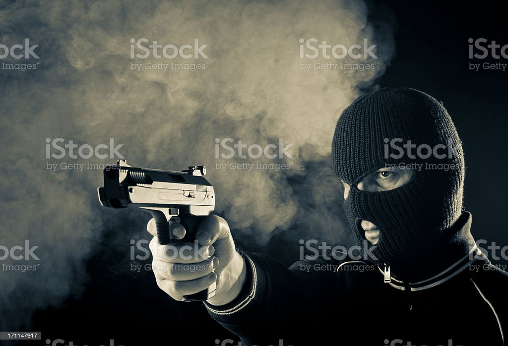 Criminal with gun royalty-free stock photo