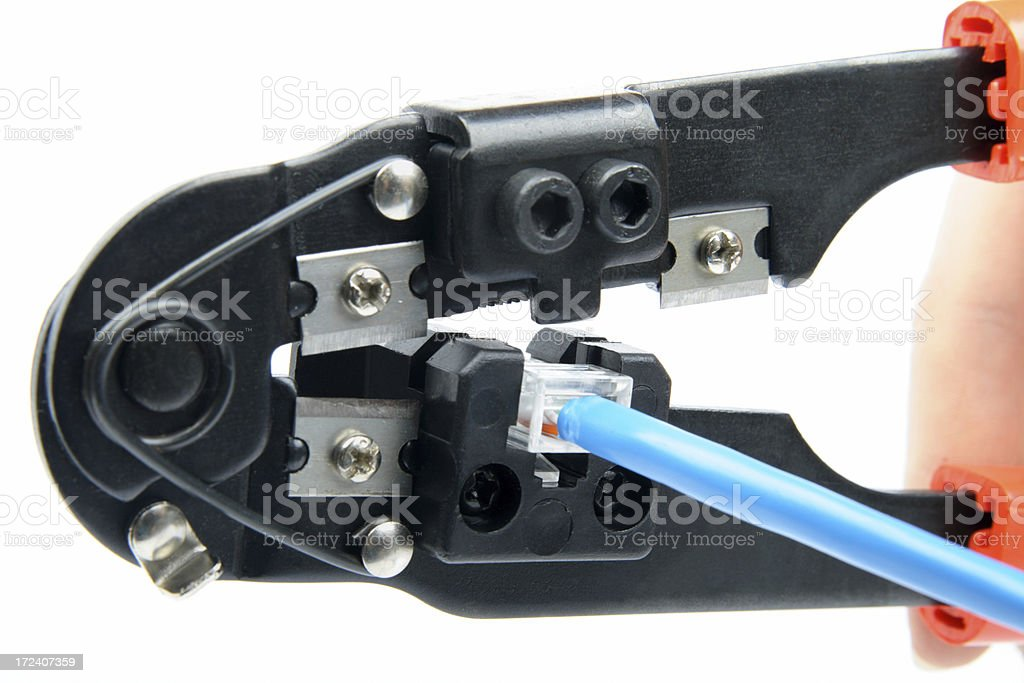 Crimp tool with RJ45 plug royalty-free stock photo