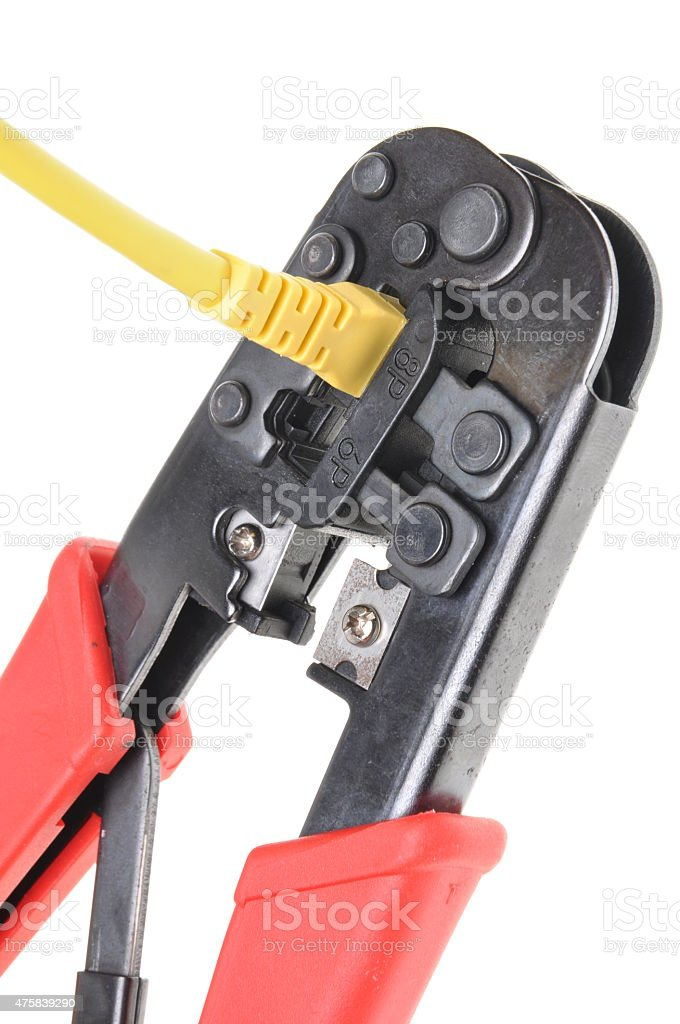 Crimping tool with a computer network cable stock photo