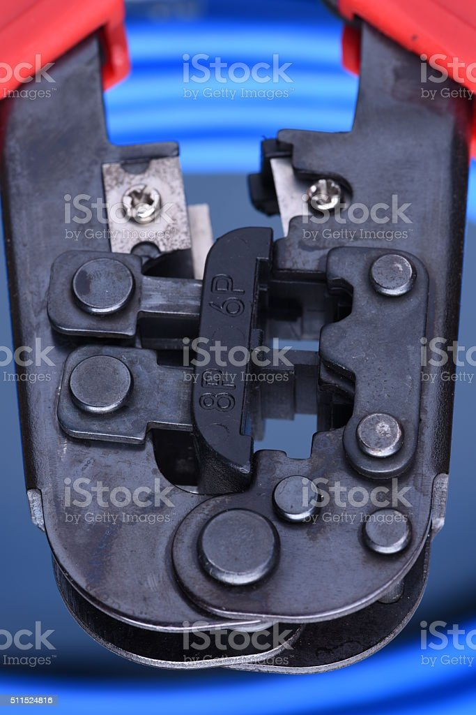 Crimping tool with cable for computer network stock photo
