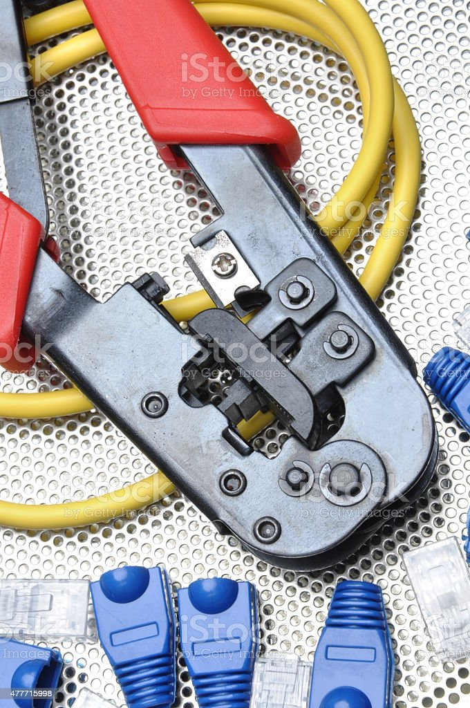 Crimping tool with network cable and connectors stock photo