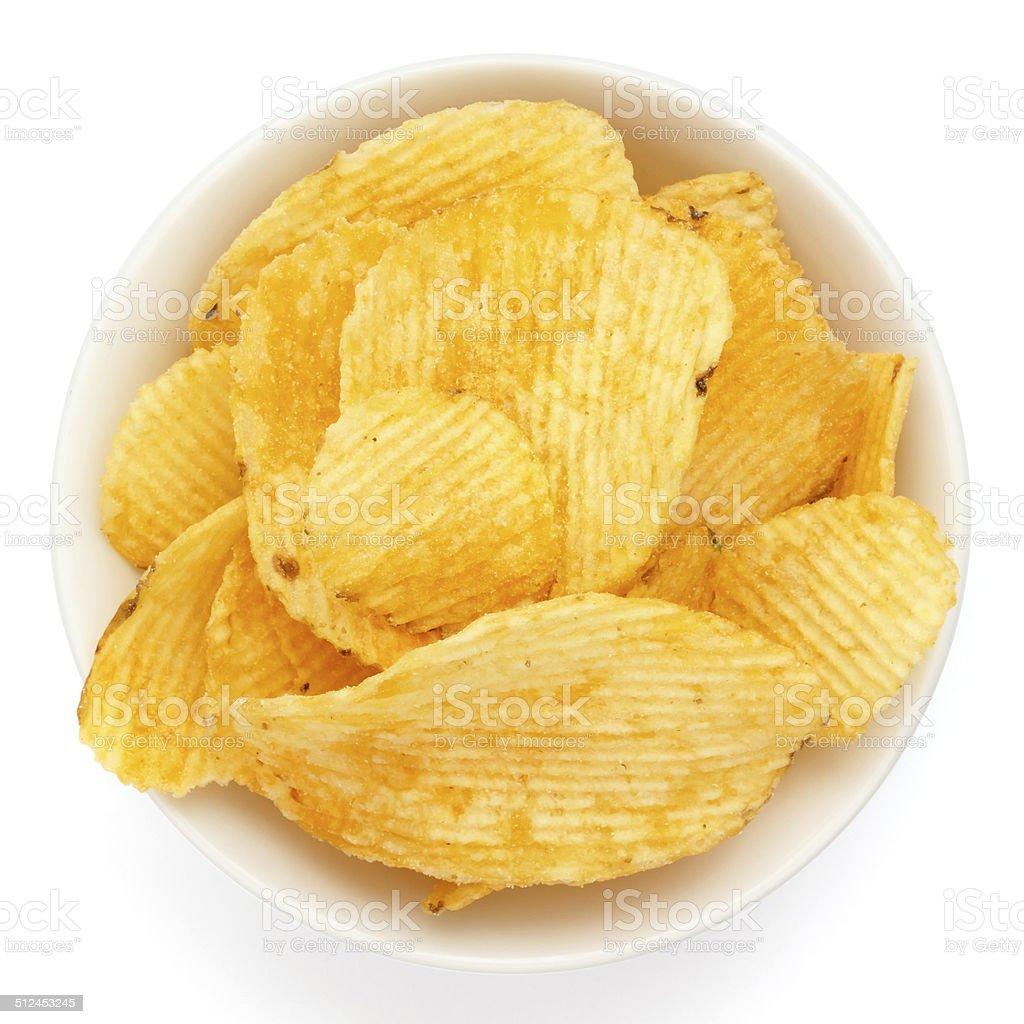 Crinkle cut crisps in a white bowl stock photo